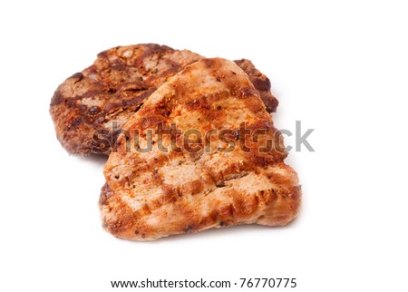 Tasty pieces of grilled meat on white background