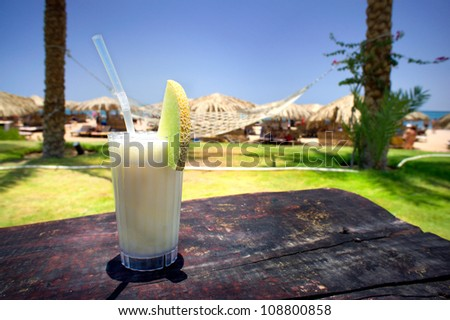 Tasty pina colada on the  old table. - stock photo