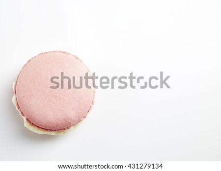 Tasty pink macaron isolated on white - stock photo