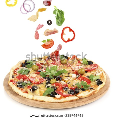 Tasty pizza and falling ingredients isolated on white - stock photo