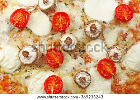Tasty pizza decorated with mushrooms, close up