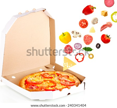 Tasty pizza in box and falling ingredients isolated on white - stock photo