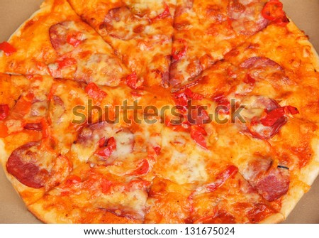 Tasty pizza in box close-up