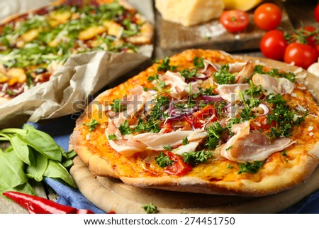 Tasty pizza on table close up - stock photo