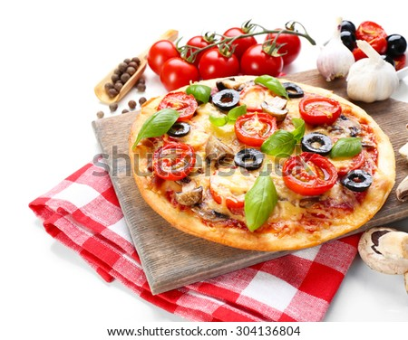 Tasty pizza with vegetables and basil on cutting board isolated on white - stock photo