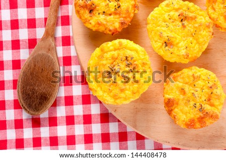 Tasty potato muffin on the wooden board - stock photo