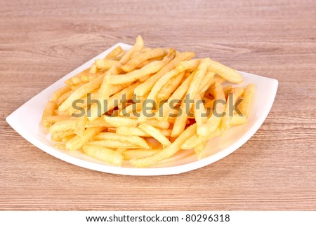 tasty potatoes in a bowl on wooden background - stock photo