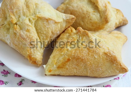 Tasty puff pastry with apple  on plate - stock photo