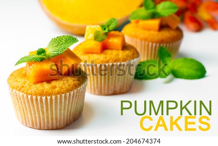 Tasty pumpkin muffins, isolated on white - stock photo
