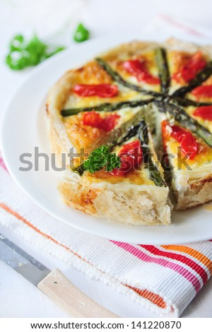 tasty quiche with tomato and asparagus