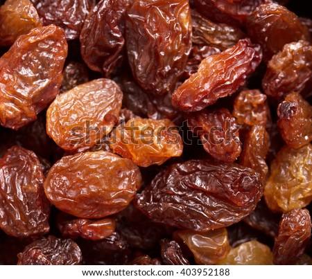 Tasty raisins as an abstract background texture. - stock photo
