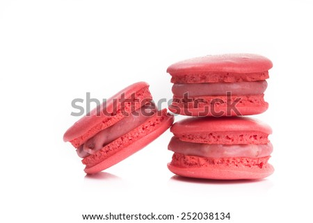 Tasty red macaroon isolate on with background - stock photo