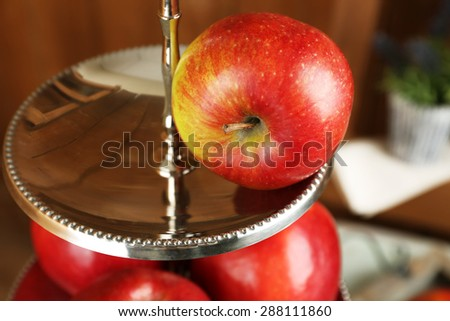Tasty ripe apples on serving tray close up - stock photo