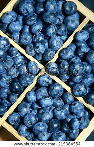 Tasty ripe blueberries in wooden crate, close up - stock photo