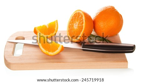 Tasty ripe oranges on cutting board isolated on white background - stock photo
