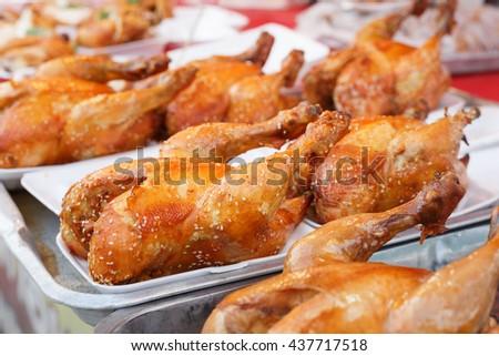 tasty roasted chicken on tray at market - stock photo