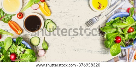 Tasty salad making with vegetables and dressing ingredients on  light rustic background, top view, banner. Healthy  lifestyle or detox diet food  concept - stock photo
