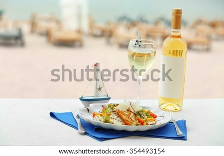 Tasty salad on white served table - stock photo
