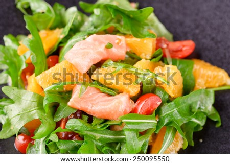 Tasty salad with salmon - stock photo