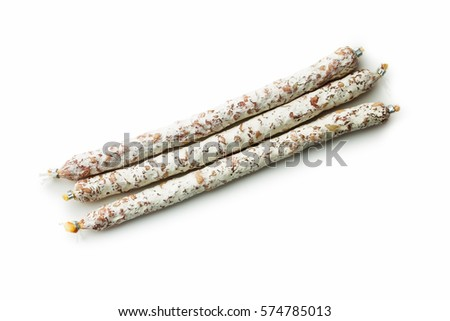 Tasty salami with white mold isolated on white background.