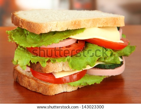 Tasty sandwich on table in cafe