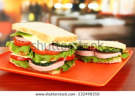 Tasty sandwiches on plate in cafe