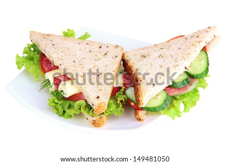Tasty sandwiches with salami sausage and vegetables on white plate, isolated on white