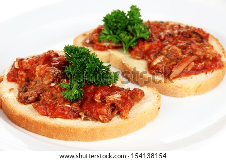 Tasty sandwiches with sardines  and tomato sauce, close-up - stock photo