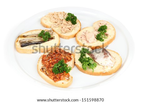 Tasty sandwiches with tuna and cod liver sardines different kinds of canned fish, isolated on white - stock photo