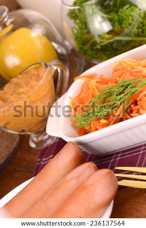 tasty sausages with carrots - stock photo