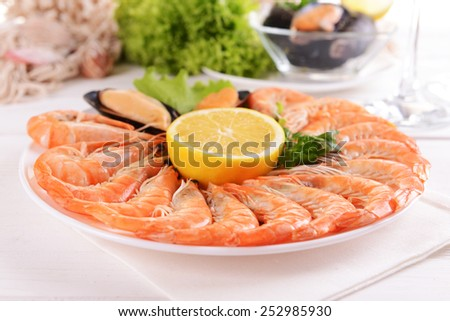 Tasty seafood on plate on table close-up - stock photo