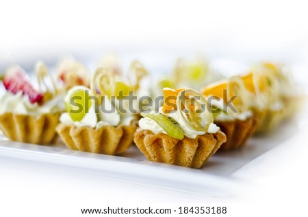 tasty snacks pastry with custard and fruit on a white background - stock photo