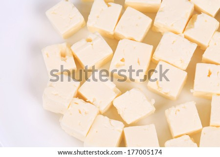 Tasty soft cheese closeup. Isolated on a white background. - stock photo