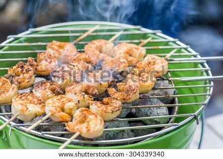 tasty spiced shrimp skewers on a barbecue