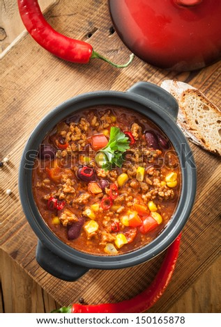 Tasty spicy chili con carne casserole in a pot for those cold winter nights, high angle view - stock photo