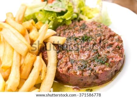 tasty Steak tartare (Raw beef) - classic steak tartare on white plate - stock photo