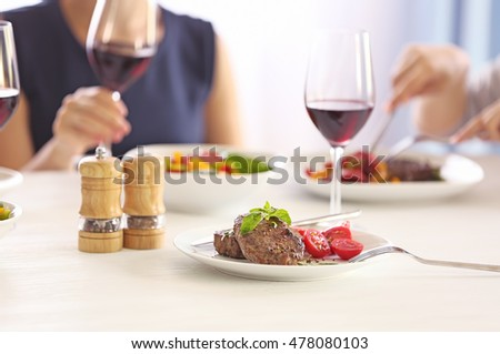 Tasty steak with fresh tomatoes on table