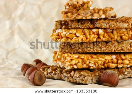 tasty sweets (kozinaki), on brown paper background