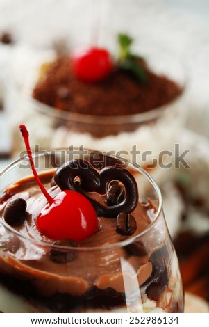 Tasty tiramisu dessert in glasses, close-up - stock photo