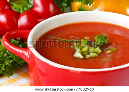 Tasty tomato soup with green paprika and herbs. - stock photo