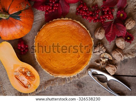 Tasty traditional homemade pumpkin tart halloween celebration party sweet dessert treat with nuts and autumn composition on vintage wooden background. Rustic style and natural light - stock photo