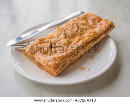 Tasty tuna patty on dish with knife and fork on the table - stock photo