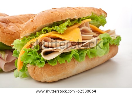 tasty turkey breast, cheese and lettuce sandwich - stock photo