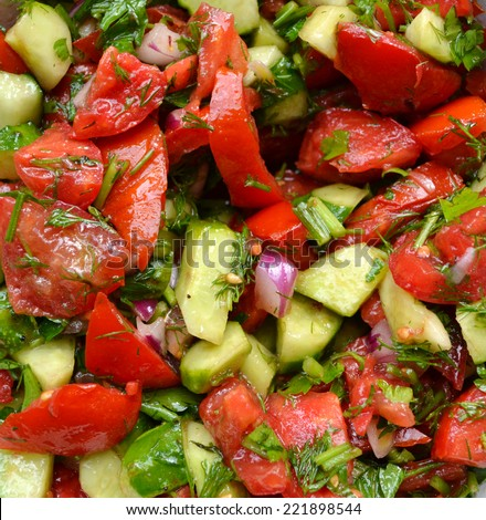 Tasty vegetarian salad with tomatoes and cucumber
