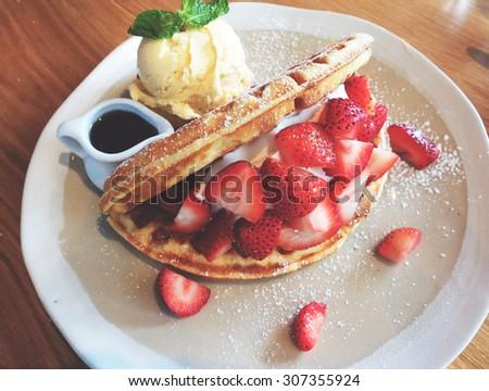 Tasty waffle and fresh strawberry with ice cream - stock photo