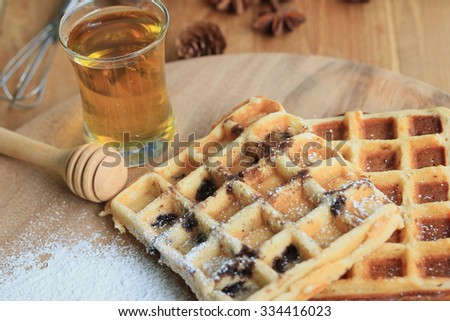 tasty waffle with honey