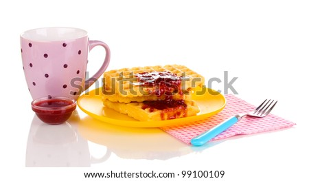 Tasty waffles with jam on plate isolated on white