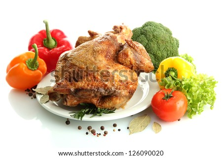Tasty whole roasted chicken on plate with vegetables, isolated on white - stock photo