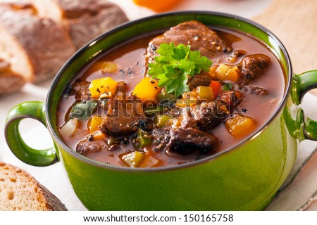 Tasty winter traditional hot pot stew with meat and vegetables stewed in a rich gravy for a wholesome meal on a cold day - stock photo