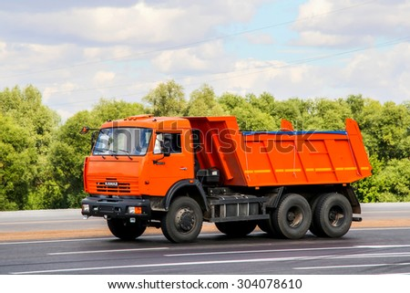 TATARSTAN, RUSSIA - AUGUST 27, 2011: Brand new dump truck KamAZ 65115 at the interurban road. - stock photo